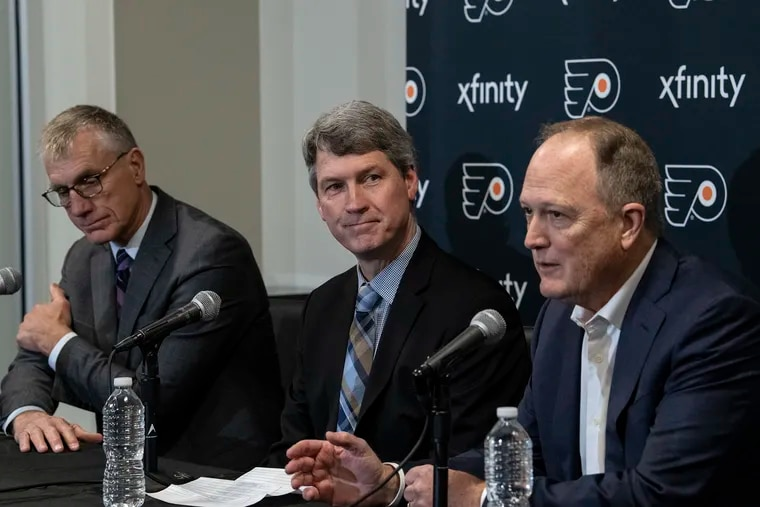 Dave Scott, Comcast Spectacor CEO, right, and Paul Holmgren, Philadelphia Flyers President, left, introduce new Flyers GM Chuck Fletcher during a press conference at the Flyers Skate Zone in Voorhees, New Jersey. Wednesday, December 5, 2018. JOSE F. MORENO / Staff Photographer