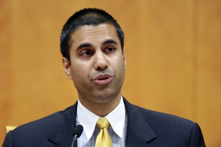 Federal Communications Commission Commissioner Ajit Pai speaks during an FCC meeting in Washington. The FCC has voted to end 'net neutrality' rules.