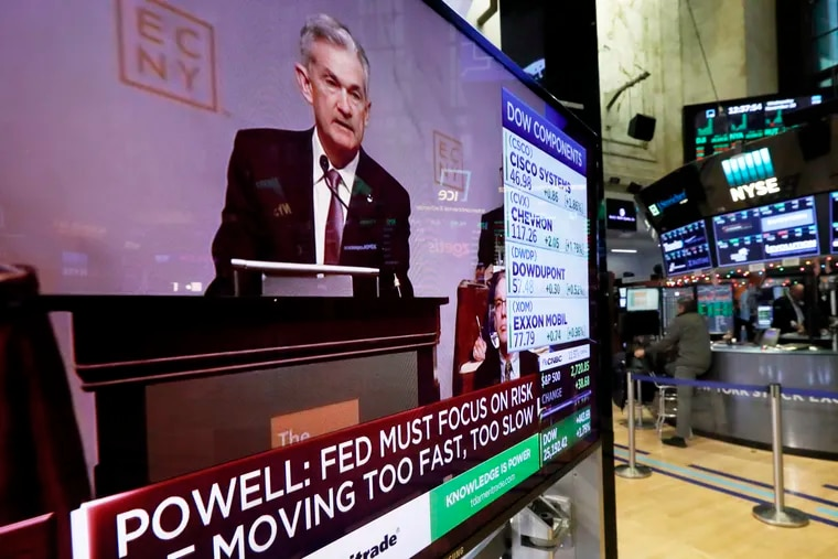 The speech of Federal Reserve Chairman Jerome Powell, to the Economic Club of New York, appears on a television screen on the floor of the New York Stock Exchange, Nov. 28. Powell cast a bright picture of the U.S. economy Wednesday and appeared to suggest that the Fed might consider a pause in its interest rate hikes next year to assess the impact of its credit tightening.