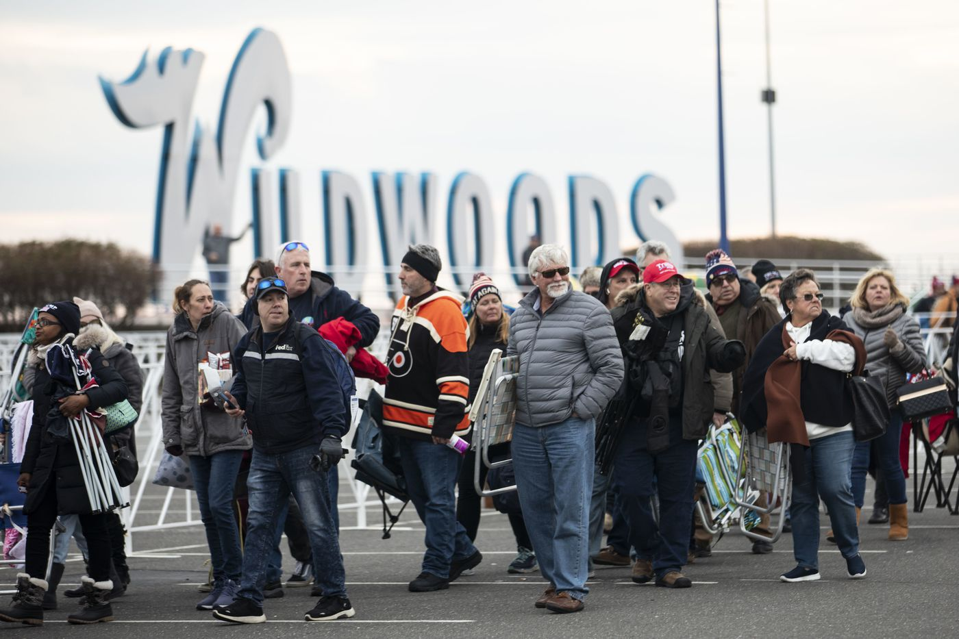 People file into lines outside of the Wildwoods Convention Center on Monday, a day before President Donald Trump's rally in the Shore town.