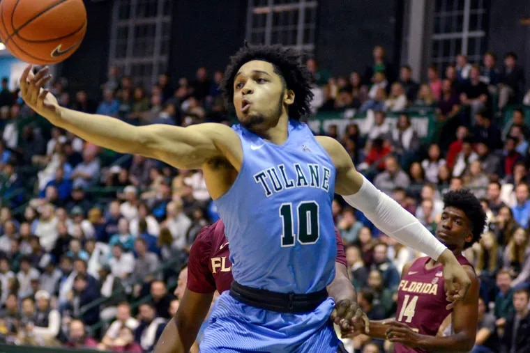 Tulane's guard Caleb Daniels, 10, fights for the ball during the first half of an NCAA Men's college basketball game against Florida State in New Orleans on Sunday, Nov. 11, 2018. (AP Photo/Veronica Dominach)