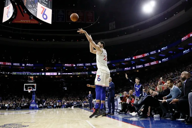 Ben Simmons drains a three-pointer during the first half of Saturday night's victory over the Cleveland Cavaliers.