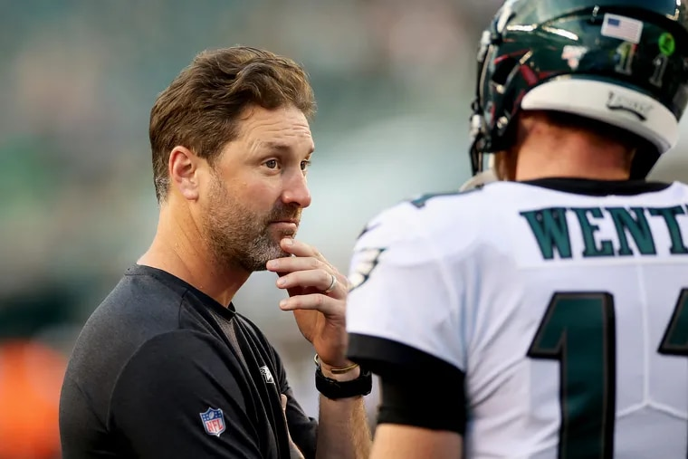Eagles offensive coordinator Mike Groh, pictured talking to quarterback Carson Wentz before a preseason game against Baltimore back on Aug. 22, will have all week to prepare what's left of the Eagles' offense after Sunday night's loss to Atlanta.      left, talks with quarterback Carson Wentz before a preseason game against the Baltimore Ravens at Lincoln Financial Field in South Philadelphia on Thursday, Aug. 22, 2019. The Eagles lost 26-15 after the game was called in the fourth quarter due to lightning.