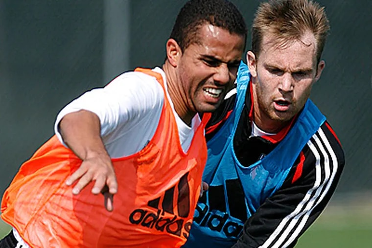 Fred, left, scrimmages against his former teammates during practice for DC United. He will face United tomorrow night. (AP Photo/Jacquelyn Martin)