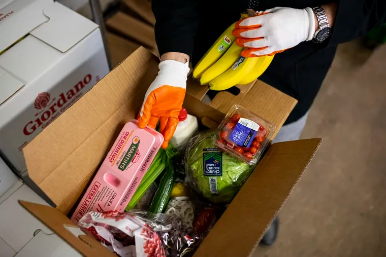 Giordano Garden Groceries of South Philadelphia, normally a wholesaler to restaurants, has shifted its focus to direct-to-consumer markets during the pandemic lockdown, and is preparing cartons of fresh food for delivery to individuals.
