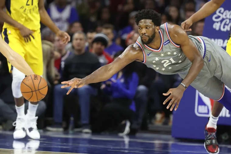 Joel Embiid of the Sixers dives for the ball after it was deflected away by the Pacers during the 2nd half at the Wells Fargo Center on Dec. 14, 2018.