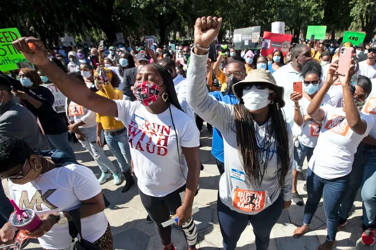 People rallied Friday to protest the shooting of Ahmaud Arbery, an unarmed black man in Brunswick, Ga. John Bazemore/AP