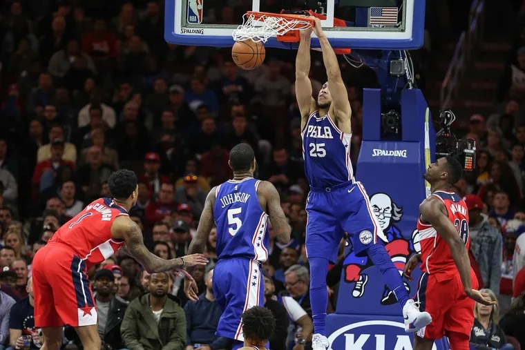 Ben Simmons dunks against the Wizards during the third quarter.