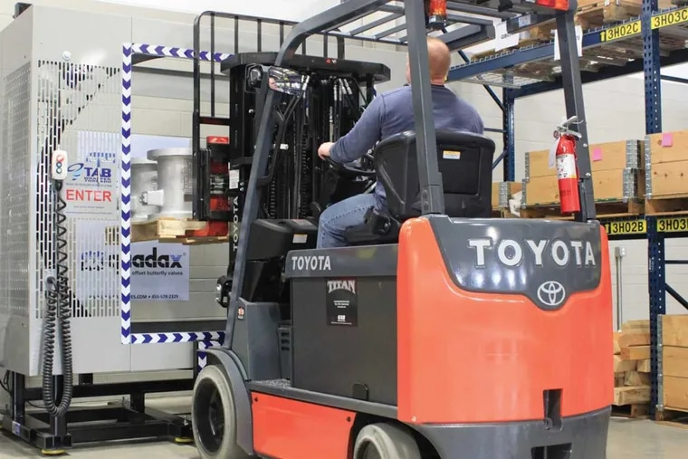 TAB Industries' TAB Wrapper binds industrial valves to skids for shipping at German-owned Co-Ax Valves' Bristol, Pa., warehouse. A new, automated TAB Wrapper runs by remote control, which Co-Ax managers say saves on labor and injury claims.
