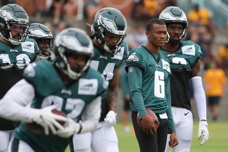 Eagles wide receiver DeVonta Smith (6) watches from the sideline while his teammates run drills during training camp at the NovaCare Complex on Tuesday.