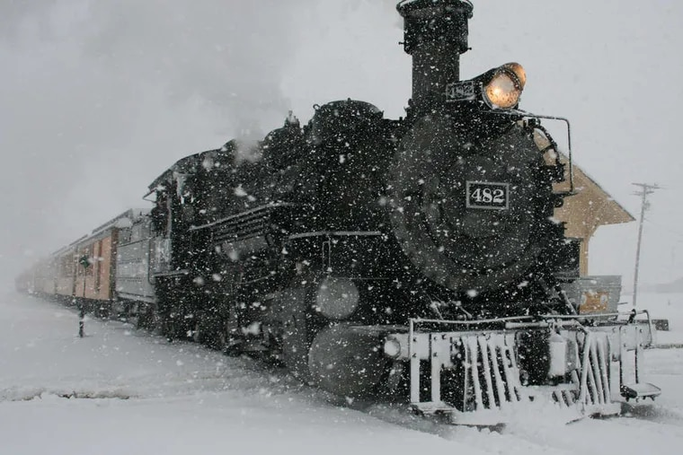 A Durango & Silverton Narrow Gauge Railroad passenger train arrives in Silverton, Colo., amid a storm that dropped more than a foot on the San Juan Mountains.