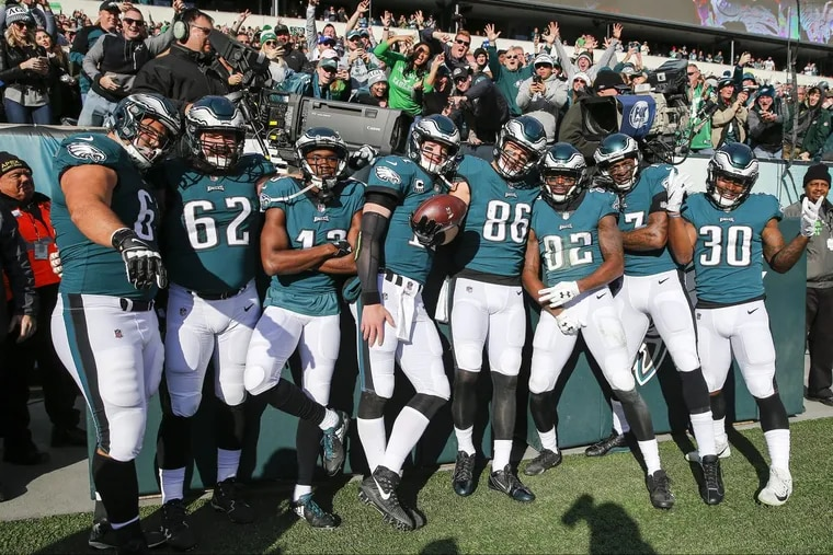 Eagles offensive players celebrate Eagles tight end Zach Ertz's first-quarter touchdown against the Bears in Week 12. YONG KIM / Staff Photographer