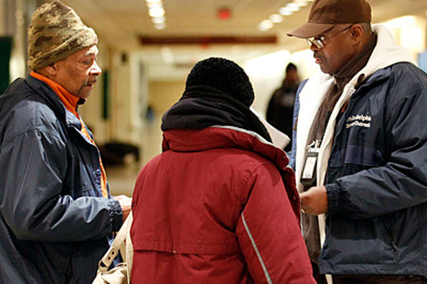 Outreach workers tend to homeless on frigid night
