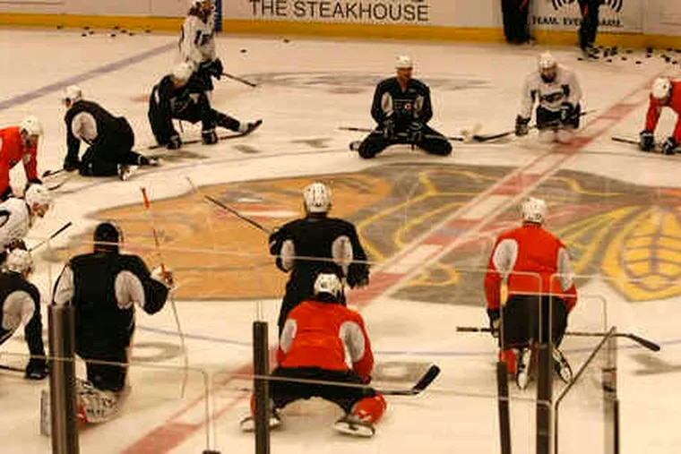 The Flyers loosen up for practice Sunday after losing Game 1. The Flyers are 14-19 in series in which they have lost Game 1.