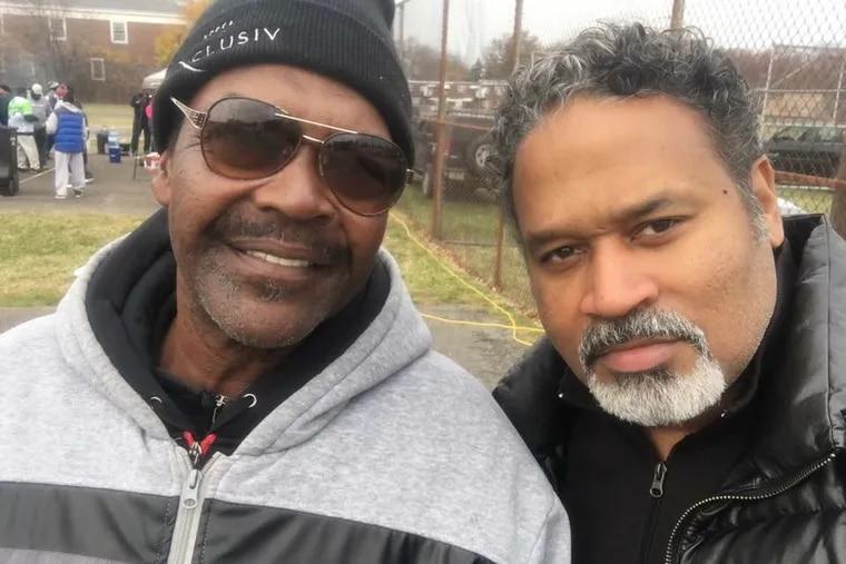 Camden sports legend Darryl 'Doc' Lee (left), with Camden graduate Denny Brown, died Friday.