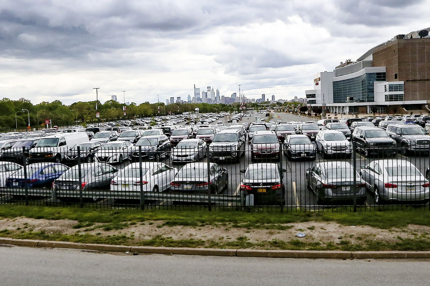 Why are so many cars parked at the stadium complex in South Philly right now?