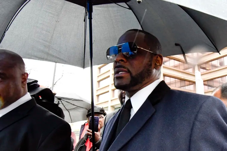 FILE - Musician R. Kelly leaves the Leighton Criminal Court building after a hearing in his sex-abuse case Tuesday, May 7, 2019, in Chicago.