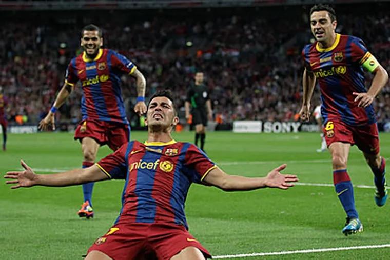 Barcelona's David Villa celebrates scoring against Manchester United. (AP Photo/Matt Dunham)