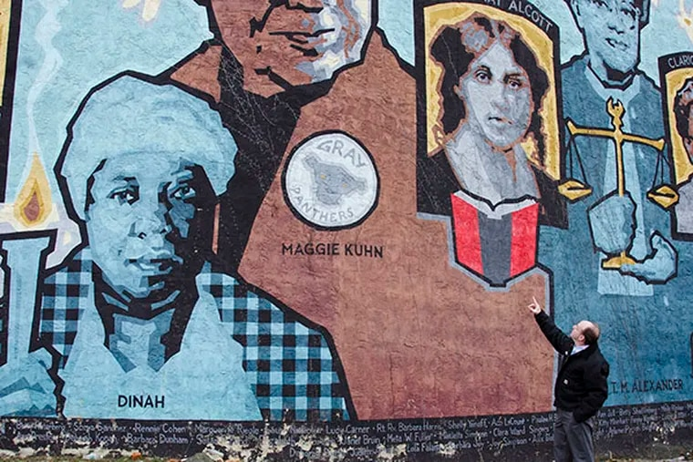 Local developer Ken Weinstein points out a portrait of Germantown activist Maggie Kuhn, who founded the Gray Panthers movement. The portrait is part of a mural on the side of the dilapidated Germantown YWCA. (RACHEL WISNIEWSKI / Staff Photographer)