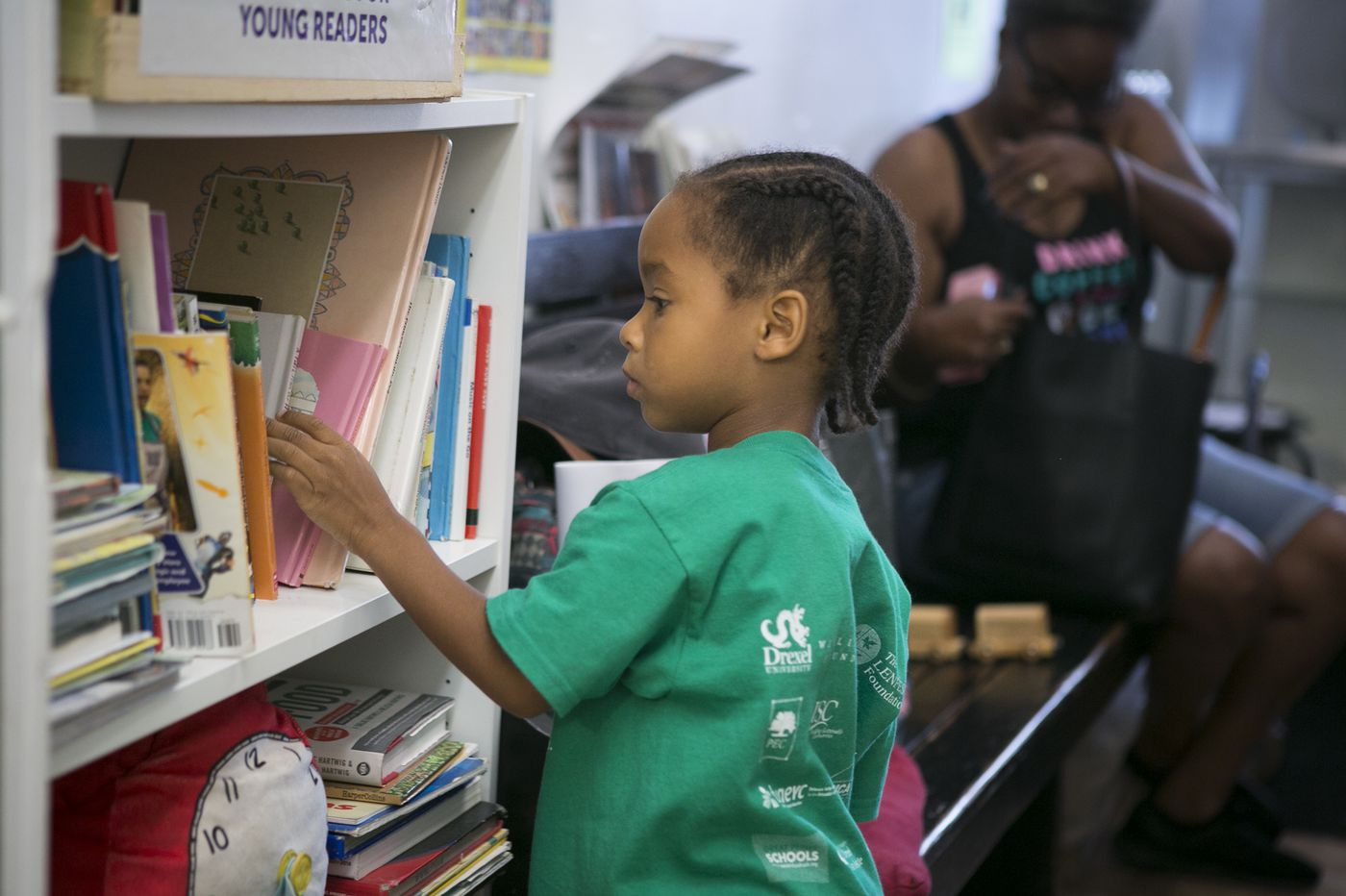 Two-thirds of Philly kids can't read at grade level. Can a library in a barbershop change that?