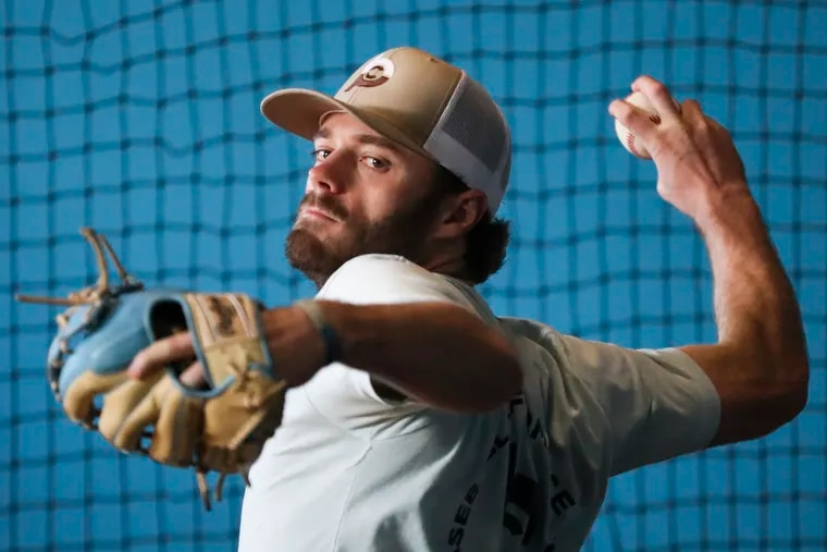 Mike Adams throws at the Baseball Performance Center in Pleasantville on Jan. 22. Adams, 26, is from South Jersey, and signed this week as a pitcher with the Phillies organization.