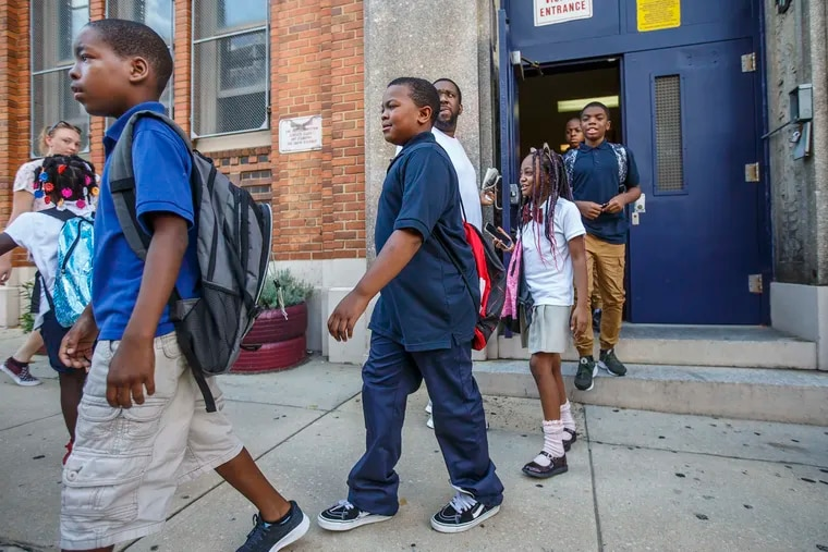 Too hot for school: District kids, like these at Dunbar Elementary in North Philadelphia. were dismissed early at the start of the year from their broiling classrooms.