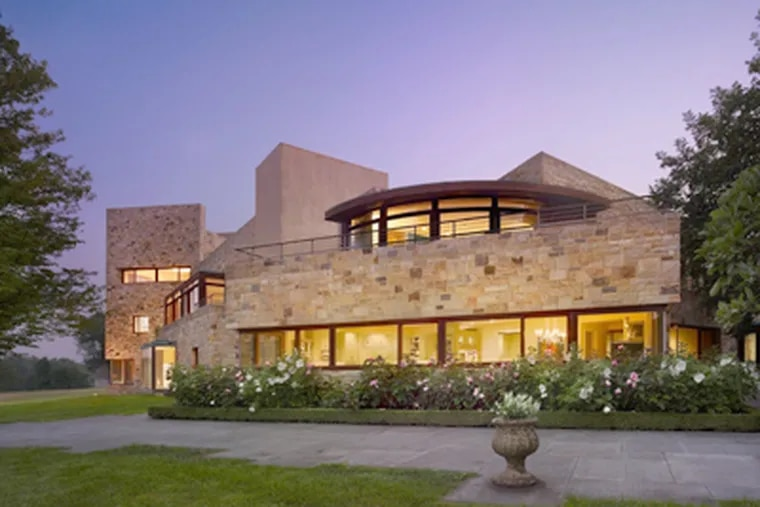 The main house, designed by Kimmel Center architect Rafael Vinoly, is built of stone, wood, glass, and Venetian glazed plaster. The Fort Washington estate is owned by Dennis Alter, former chief executive of Advanta.