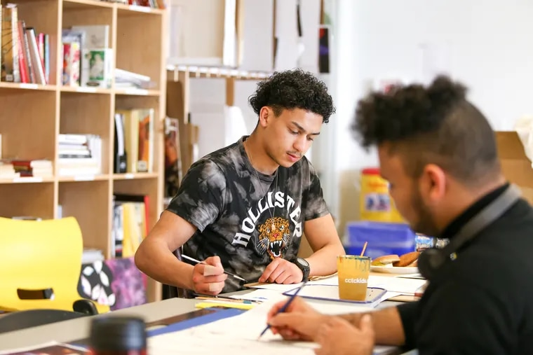 Andres Vasquez, 18, paints with watercolors at Taller Puertorriqueno. Vasquez has been accepted to nine different colleges for art, and gets much of his inspiration from Japanese anime.