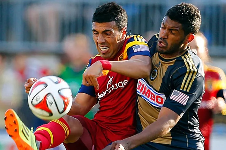 Real Salt Lake's Javier Morales, left, of Argentina, battles for the ball with Philadelphia Union's Sheanon Williams (25) during the second half of an MLS soccer match at PPL Park in Chester, Pa., Saturday, April 12, 2014. The match ended in a 2-2 draw. (Rich Schultz/AP)
