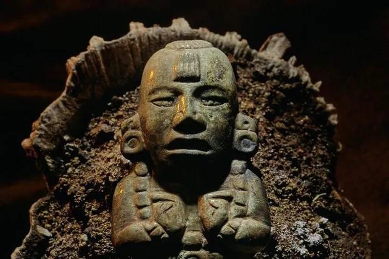 Figure of the Maize God in Shell.   Royal Maya Tomb II