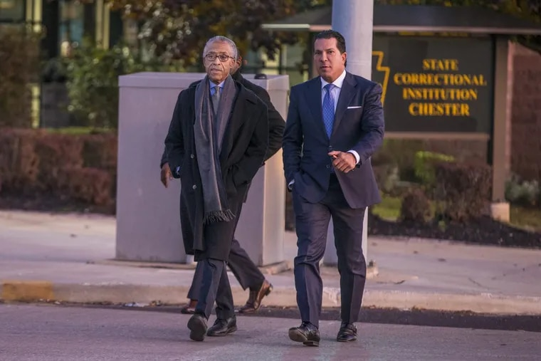 The Rev. Al Sharpton (left) and attorney Joe Tacopina walk out of the State Correctional Institution in Chester after talking to rapper Meek Mill on Monday.