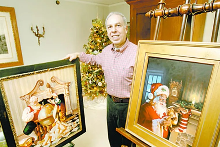 Artist and illustrator Ernie Norcia of Wallingford is know for his paintings of Santa as well as other illustrations. He is shown in his home with 2 of his Santa paintings. (Charles Fox / Staff Photographer)