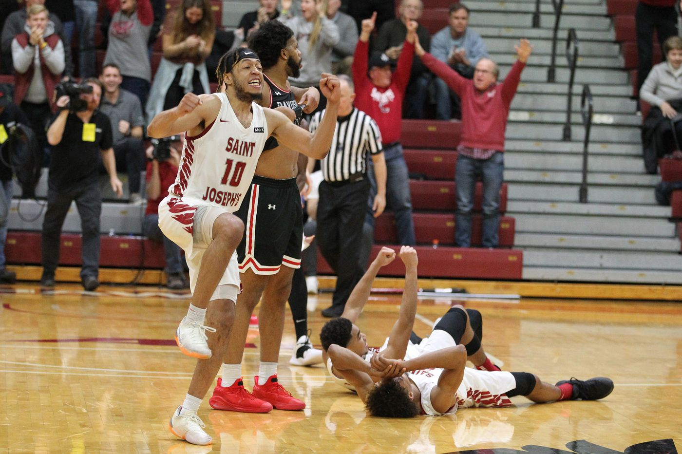 Undermanned St. Joseph's knocks off Davidson to end four-game losing streak