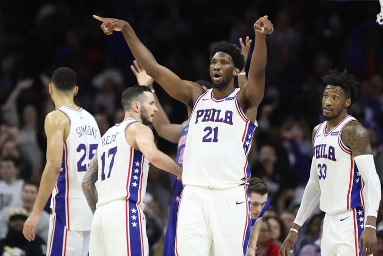 Joel Embiid, center of the Sixers leads the crowd in singing goodbye after Andre Drummond of the Pistons fouled out in the 4th quarter at the Wells Fargo Center on Dec. 2, 2017. CHARLES FOX / Staff Photographer
