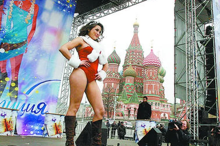 A Miss Constitution contestant performs on stage in frigid Moscow, with the Kremlin as a backdrop. Participants faced questions about Russian authority and the role of the elite.
