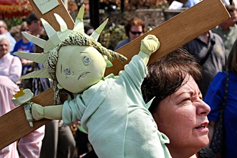 A Statue of Liberty on a crucifix, made by South Philadelphia resident Mary DeChristopher for the Independence Mall rally. TOM GRALISH / Staff Photographer
