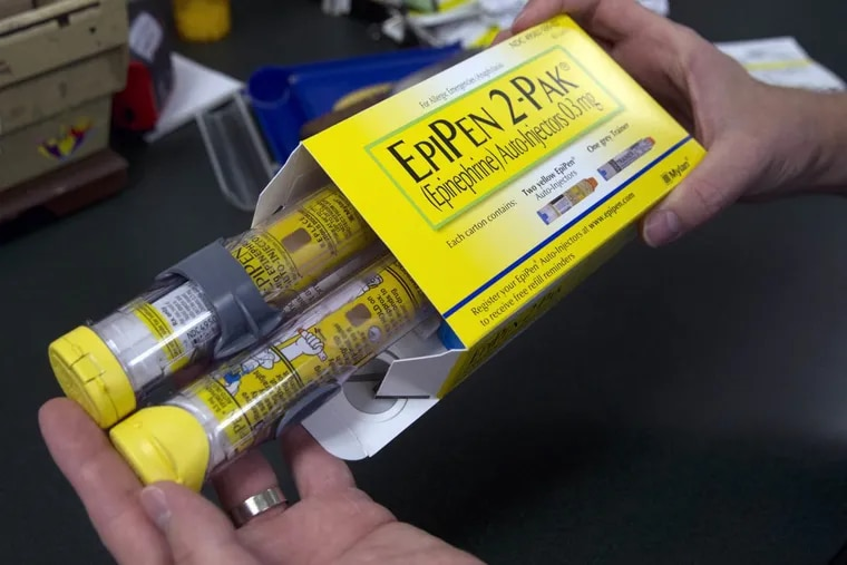 FILE: Pharmacist Clint Hopkins displays a package of EpiPens, an epinephrine autoinjector for the treatment of allergic reactions, manufactured by Mylan.  (AP Photo)
