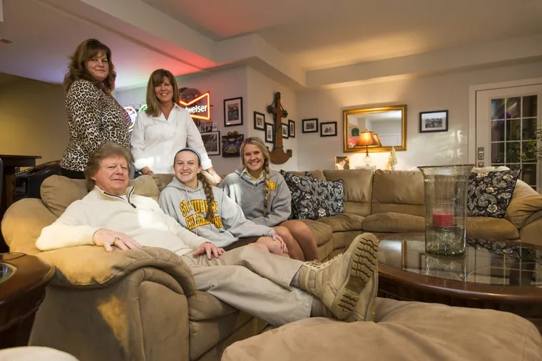 Joe Mahon and his wife, Kathleen (standing left), share a home with Joe's daughter, Lynda Schmidt (standing right), and her daughters Erin (center) and Meghan Schmidt in Huntingdon Valley. The family shares the basement and some other common areas. Joe and Kathleen have an in-law suite on the second floor.