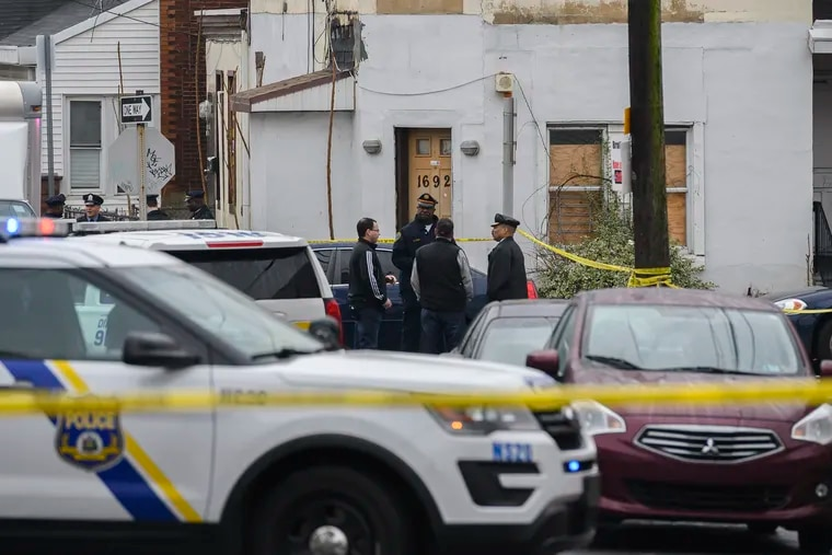 Police investigate the scene where Philadelphia SWAT team officer Cpl. James O'Connor IV, 46, was fatally shot on the 1600 block of Bridge Street in the city's Frankford section on Friday, March 13, 2020.