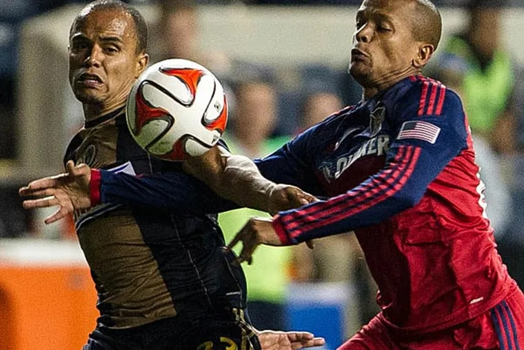 Chicago Fire forward Robert Earnshaw (88) and Philadelphia Union defender Fabinho (33) battle for the ball during the second half of the match at PPL Park. The match ended in a 1-1 draw. (John Geliebter/USA Today)