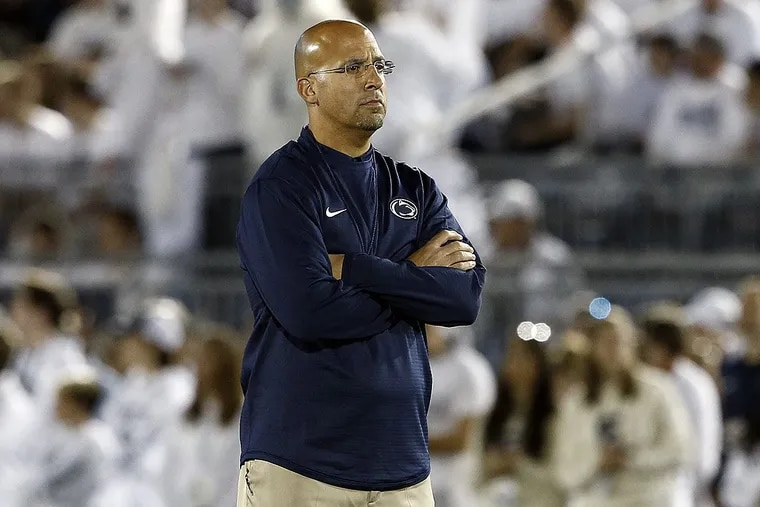 Penn State head coach James Franklin, stands on the field and watches Michigan during pre-game warm ups, before an NCAA college football game in State College, Pa., Saturday, Oct. 21, 2017.