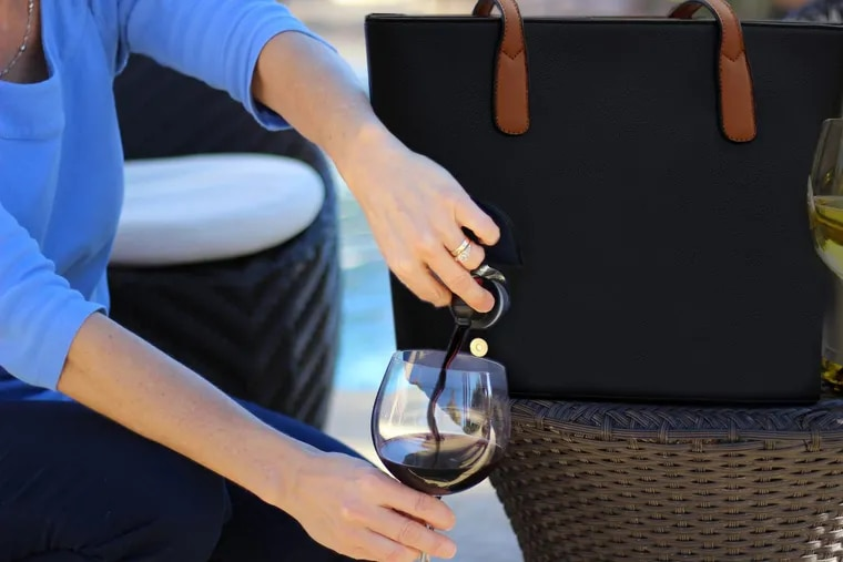 This faux-leather bag from Pheonix-based company Bella Vita lets you bring your wine with you, well, everywhere.