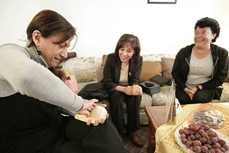 Jeannette Dakhallah, left, 51, learns breast self examination using an artificial breast as Hiam Hamade, 55, center, and Diana Awada, 56, watch. (Patricia Beck/Detroit Free Press/MCT)