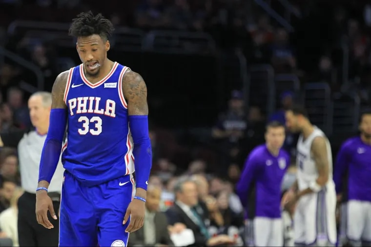 Robert Covington of the Sixers walks down the court dejected late in their game against the Sacramento Kings at the Wells Fargo Center on Dec. 19, 2017. Covington shot 2-13 from the 3-point line. CHARLES FOX / Staff Photographer