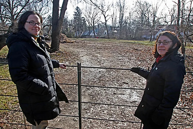 """At the meadow are the Lower Merion Conservancy's Patty Thompson (left) and Rita Auritt. """"It's a big deal to protect property like this in such a developed area,"""" Thompson said. (Akira Suwa / Staff Photographer)"""