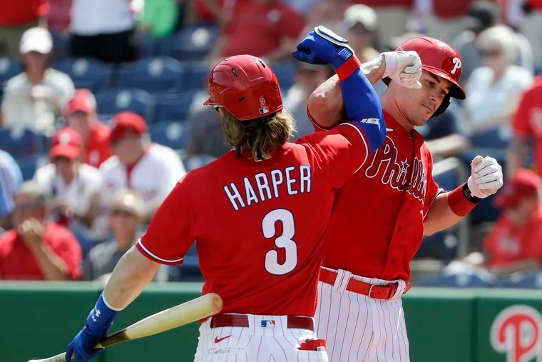 The Phillies' J.T. Realmuto celebrated his first-inning solo home run with teammate Bryce Harper against the Pittsburgh Pirates in a spring training game  in Clearwater, Fla., in March.