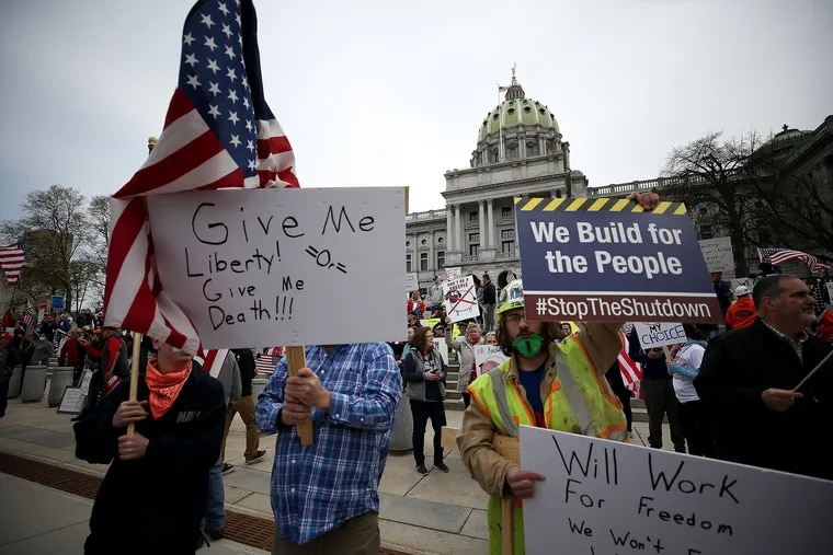 Protesters gather outside the Capitol complex in Harrisburg on Monday.