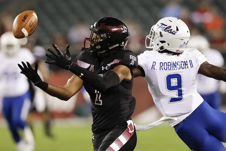 Temple wide receiver Ventell Bryant watches the football against Tulsa cornerback Reggie Robinson II on Thursday, September 20, 2018 in Philadelphia. YONG KIM / Staff Photographer
