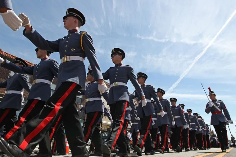 Members of B Company Infantry Unit from Valley Forge Military Academy march on Lancaster Avenue during the Memorial Day Parade in Radnor.