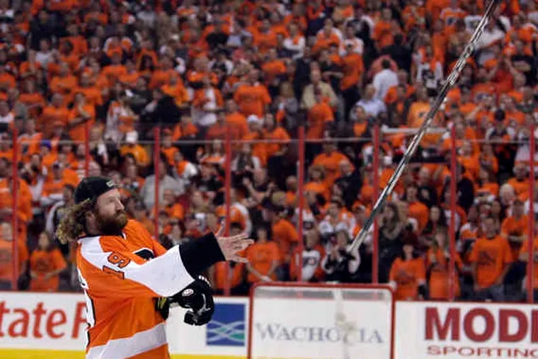Scott Hartnell tosses his stick into the crowd as the Flyers celebrate their berth in the Stanley Cup finals.